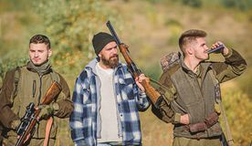 Hunters with rifles in nature environment. Illegal hunting. Hunters brutal poachers. Poacher partner in crime. Poaching. Concept. Activity for brutal men royalty free stock image