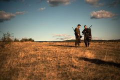 HunterS with shotgun gun on hunt. Calibers of hunting rifles. HunterS in camouflage clothes ready to hunt with hunting. Rifle royalty free stock photos