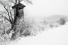 Hunters stand in snowy country Royalty Free Stock Images