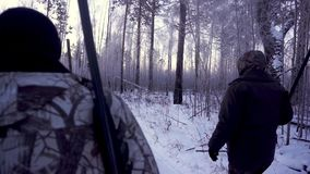 Hunters in the Woods. Armed Rangers in winter forest stock footage
