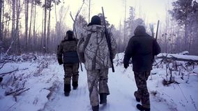 Hunters in the Woods. Armed Rangers in winter forest.  stock video