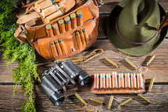 Hunting accessories in a forester cottage. On old wooden table Stock Photos