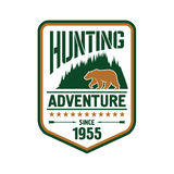 Hunting and adventure retro badge design with bear Royalty Free Stock Photo