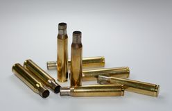 Hunting ammunition and empty rifle bullet cartridges on white. stock photo