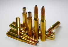 Hunting ammunition and empty rifle bullet cartridges on whitye. Hunting ammunition and empty rifle bullet cartridges  on white background Stock Photo