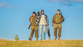 Hunting as hobby and leisure. Hunters with guns walk sunny fall day. Brutal hobby. Guys gathered for hunting. Group men. Hunters or gamekeepers nature royalty free stock image