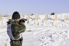 Hunting biathlon championship Member. Photo competitor standing on the shooting range before the shot during hunting biathlon competitions taking place in Royalty Free Stock Image