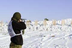 Hunting biathlon. Photo competitor standing on the shooting range before the shot during hunting biathlon competitions taking place in the village of Paranga Stock Photo