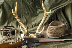 Hunting carbine,old trap,cowboy hat Royalty Free Stock Images