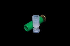 Hunting cartridge and container. Green hunting cartridge and container Stock Photography