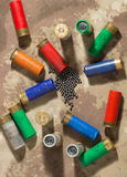 Hunting cartridges and lead shot . Clouse up Stock Images