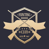Hunting club vintage logo with two crossed rifles Stock Images