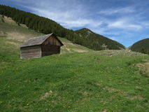 Hunting cottage in Carpathian mountains. In pastures open areas Royalty Free Stock Photo