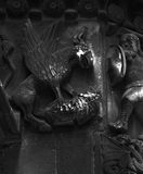 The hunting creature. Shot in black and white, detail on an sculpture representing a strange winged creature, placed on the facade of this historic cathedral a Stock Image