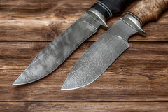 Hunting damascus steel knives handmade on wooden background Stock Images