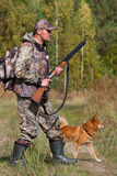 Hunting with dog Stock Image