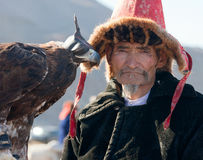 Hunting with eagles. In the Mongolian Altai. Traditionally Kazakh fun. The Golden Eagle Festival Royalty Free Stock Images