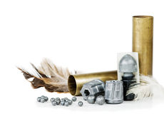 Hunting equipment. Hunting cartridges, bullets and lead shot, isolated on white background Royalty Free Stock Photography