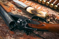 Hunting equipment on old wooden background Royalty Free Stock Photos