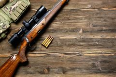 Hunting equipment on old wooden background. Hunting rifle and ammunition on a dark wooden background.Top view Stock Photography