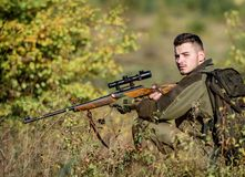 Hunting equipment for professionals. Hunting is brutal masculine hobby. Hunter hold rifle. Man wear camouflage clothes. Nature background. Hunting permit royalty free stock images