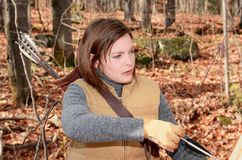 Hunting during fall. Woman hunting in forest during fall Stock Photo