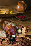 Hunting food on old table. Wild pheasant and fruit in an old master hunting still life Royalty Free Stock Images