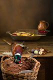 Hunting food. Wild pheasant and fruit in an old master hunting still life Royalty Free Stock Photo