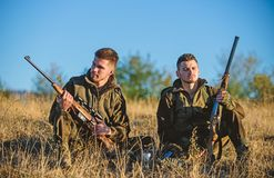 Hunting with friends hobby leisure. Rest for real men concept. Hunters gamekeepers relaxing. Discussing catch. Hunters. Rest for real men concept. Hunters stock image
