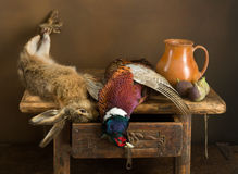 Hunting game and figs. Antique old master hunting still life with pheasant and hare Stock Photography