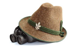 Hunting gear. Old hunting hat and binoculars Royalty Free Stock Images