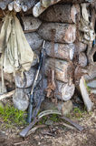 Hunting gear at log cabin Stock Photography