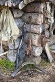 Hunting gear at log cabin Stock Photography
