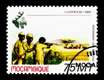Hunting group, Hunting World Expo - Expo 81 serie, circa 1981. MOSCOW, RUSSIA - NOVEMBER 25, 2017: A stamp printed in Mozambique shows Hunting group, Hunting Royalty Free Stock Image