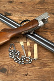 Hunting gun with cleaning kit on a table Stock Photos