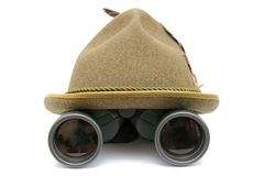 Hunting hat. Arrangement with oktoberfest hunting hat and binoculars over white background Stock Photography