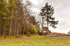 Hunting hide in the forest. Hunting stash. The wooden tower. Stock Photos
