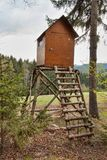 Hunting hide in the forest. Hunting stash. The wooden tower. Royalty Free Stock Image