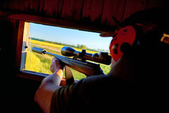 Hunting on high seat. With ear protection Stock Image