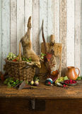 Hunting horn and dead game. Antique old master hunting still life with pheasant and hare Royalty Free Stock Image