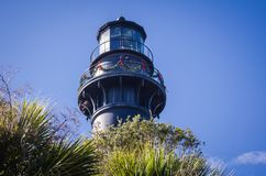 Hunting Island lighthouse in South Carolina decorated for Christmas. Against a blue sky stock image
