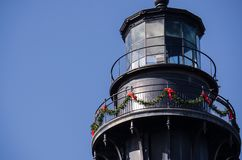 Hunting Island lighthouse in South Carolina decorated for Christmas. Against a blue sky royalty free stock photos
