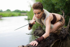 Hunting with a knife Stock Photography