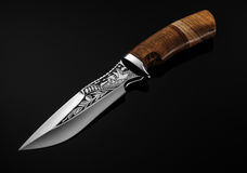 Hunting Knife on a black background. Hunting Knife on a black background Royalty Free Stock Photo