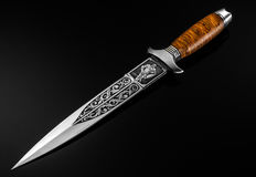 Hunting Knife on a black background. Hunting Knife on a black background Stock Image