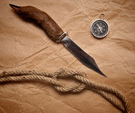 Hunting knife, compass and rope Stock Image