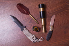 Hunting knife, fountain pen and ink Royalty Free Stock Photo