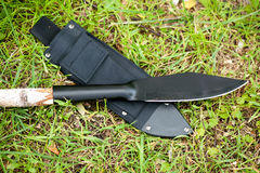 Hunting knife on the grass Royalty Free Stock Photos