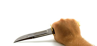 The hunting knife in a hand Stock Photography