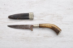 Hunting knife with leather sheath Stock Photo